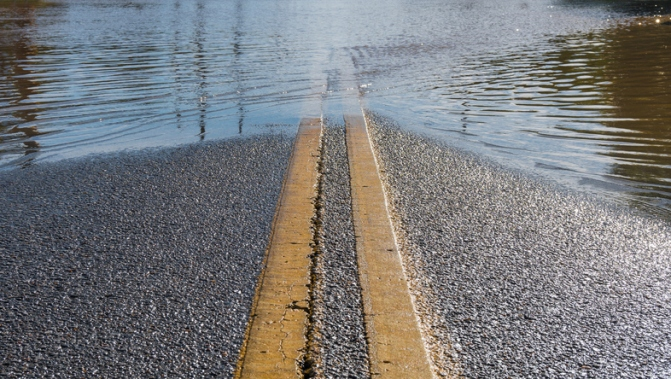 Road Leading into Flooded Street